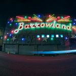 The Barrowland Ballroom music venue in Glasgow lit up at night with a neon sign